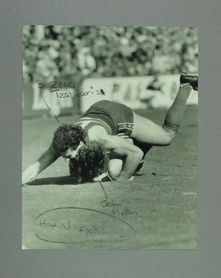 Photograph of footballers Zeno Tzatzaris and John Platten during a match, c 1980s