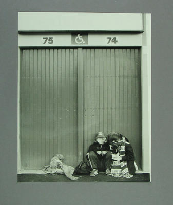 Photograph of two young Carlton FC supporters sitting outside the MCG, c 1980s