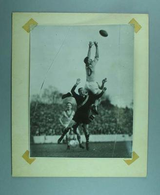Photograph of three football players attempting a mark, c1930s; Photography; 1992.2558.27