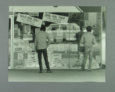 """Photograph of appliance shop with window advertisements, """"Grand Final Fever"""" - 1986"""
