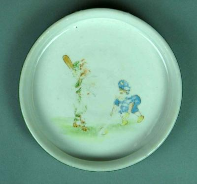 Dish with images of two children playing cricket.