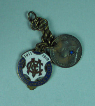 Melbourne CC membership medallion for season 1911/12 with 1898 British farthing attached by chain