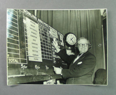Photograph, Hector Harris in 3AW broadcasting studio with cricket scores