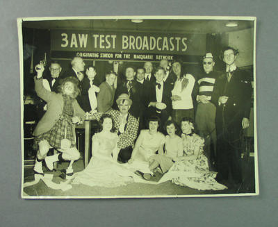 Photograph, depicts 3AW broadcast studio with a group of people, some in fancy dress