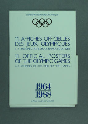 Card wallet for 11 coloured postcard reproductions of official Olympic Games posters,  together with 1 coloured postcard of 2 symbols of the 1988 Olympic Games; period  1964 - 1988, issued by the I.O.C. in 1985; Documents and books; 1986.14.39