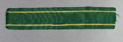 Piece of green & gold ribbon, possibly part of a hat band