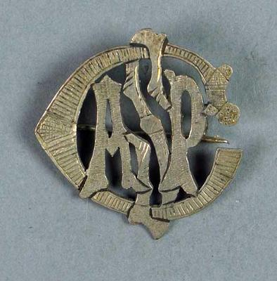 Silver badge with ASPC monogram, awarded to Lily Beaurepaire in 1910-20