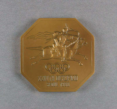 Octagonal commemorative medallion from the 1988 Seoul Olympic Games.