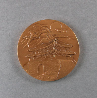 Circular commemorative medal from the 1988 Seoul Olympic Games.