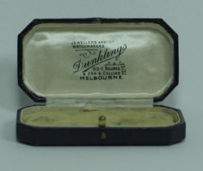 Dark blue presentation case for  Percy Bowyer's V.F.L. Premiership medals