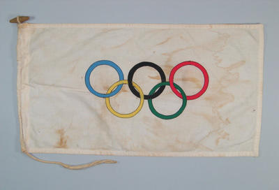 Olympic Flag flown on Qantas aircraft carrying Olympic Flame to Australia, 1956 Melbourne Olympics; Flags and signage; 2000.3706.2