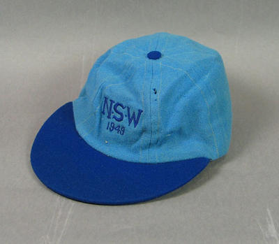 "Baseball cap - light blue with ""N.S.W. 1949""  stitched on the front."