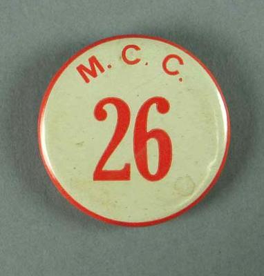 "Badge worn by MCG event duty staff, ""MCC 26"""