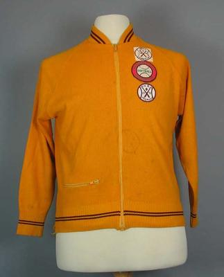 Zip up softball jacket, with three embroidered badges affixed