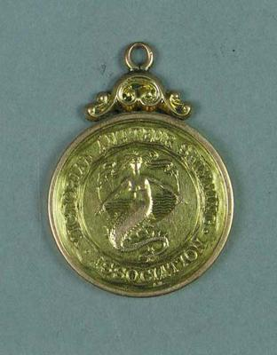 Gold medal for first place in the 100 yard swim race at V.A.S.A. competition 19 July 1908, won by Lily Beaurepaire