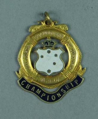 Gold medal for second place in the 100 yard swim race at V.L.A.S.A. competition 16 March 1918, won by Lily Beaurepaire