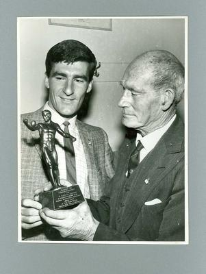 Photograph of Harry Morris presenting a trophy to Derek Clayton, 1961