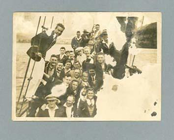 Photograph, depicts a group of athletes on a boat - c1927