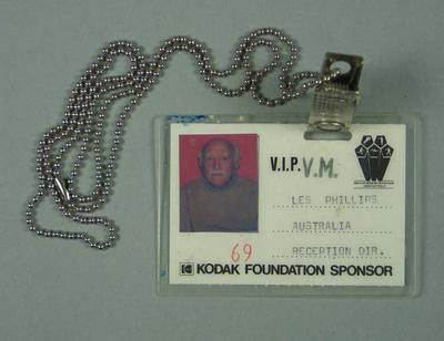 Laminated identification card - No. 69 - with clip and chain. Photograph of Les Phillips, Australia, Reception Director, Amateur Modern Pentathlon Union of Australia.; Documents and books; 1986.1265.2