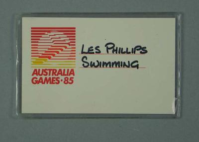 Identification card in plastic sleeve. Logo of Australia Games 1985; handwritten Les Phillips, Swimming; Documents and books; 1986.1265.5