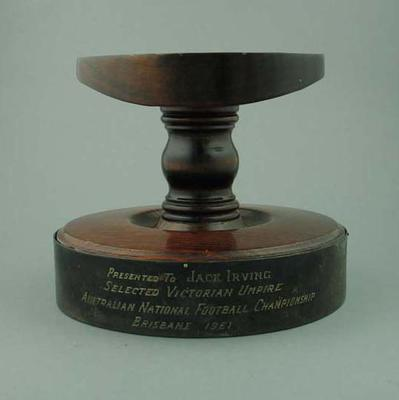 Stand for football presented to Jack Irving, Victorian Umpire at 1961 ANFC Carnival