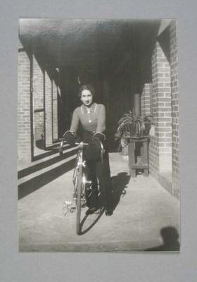 Photograph of Dot Edney [Mansell] standing beside her bicycle in 1936; Photography; 2006.4508