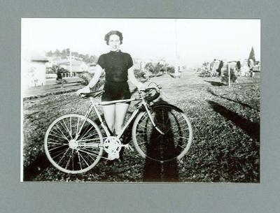 Photograph of Dot Edney [Mansell] holding  her bicycle c. 1930s; Photography; 2006.4510