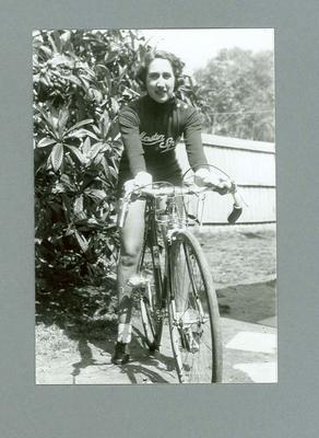 Photograph of Dot Edney [Mansell] sitting astride her bicycle, 1939 at Glen Iris; Photography; 2006.4512
