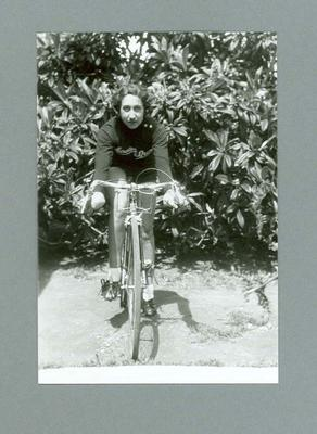 Photograph of Dot Edney [Mansell] sitting astride her bicycle, 1939 at Glen Iris; Photography; 2006.4513