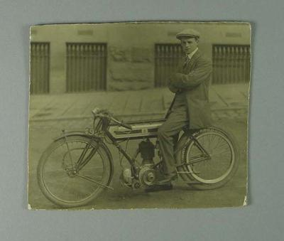 Black and white photograph of Jack Lukey aged 21 on his Triumph racing motorcycle.