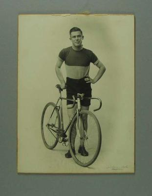 Black and white photograph of cyclist Laurie Jones with Preston Star bike made by Rupert Bates