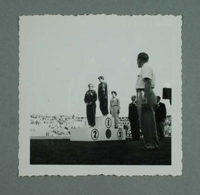 Photograph of Marjorie Jackson, Winsome Cripps and Edna Maskell on dais - 1954 Commonwealth Games