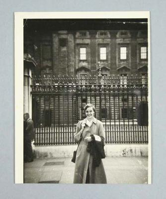 Photograph of Winsome Cripps outside Buckingham Place, 1952