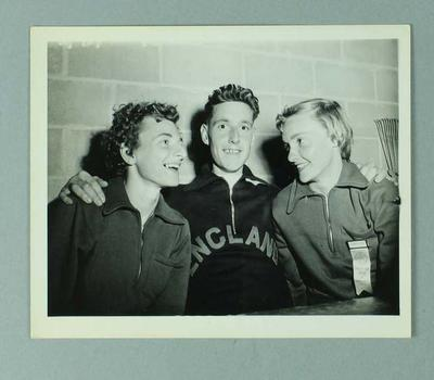 Photograph of Marjorie Jackson and Winsome Cripps with male English athlete, 1954 British Empire & Commonwealth Games