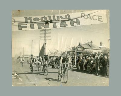 Photograph of cyclist Chris Wheeler crossing Healing Race finish line