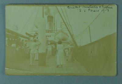 Postcard of cricket being played on board SS Pursic, 1913