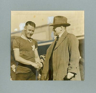 Photograph - cyclist Chris Wheeler shaking hands with unknown man, 11/9/1935; Photography; 2006.4627