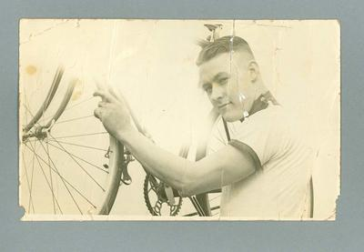 Phiotograph of cyclist Chris Wheeler holding his bicycle; Photography; 2006.4628
