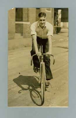 Photograph of cyclist Chris Wheeler on his bicycle, 20 March 1936