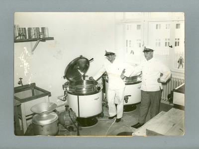 Photograph of two naval cooks in a kitchen, taken in 1936