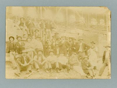 Photograph of workmen at Melbourne Cricket Ground, early twentieth century