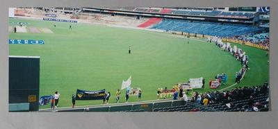 Colour photograph of children participating in a banner display competition on the MCG, March 2004