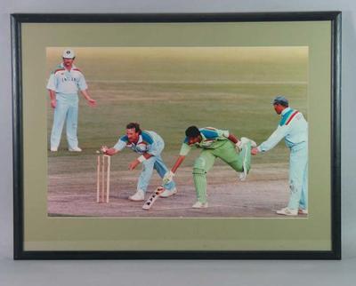 Framed colour action photograph of Ian Botham and Graham Gooch
