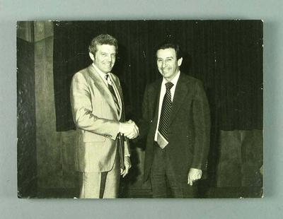 Black and white photograph of Brian Dixon shaking hands with Bert Keddie
