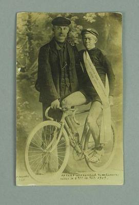 Photographic postcard - Iddo Munro, Australasian Road Championship Season 1909-10 and Mr. Johnston holding cycle.