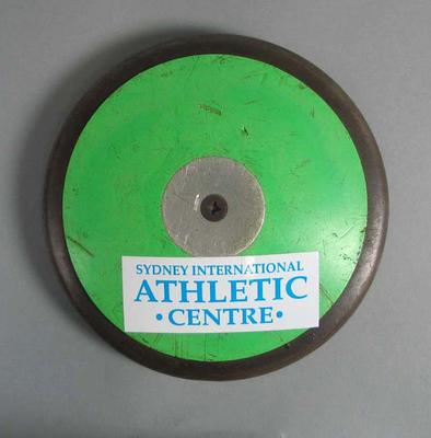 Discus with label ' Sydney International Athletic Centre'