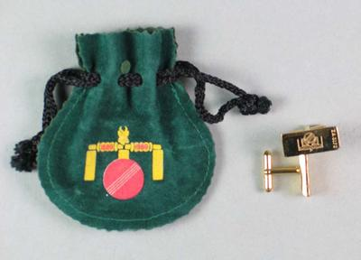 Pair of cuff links issued by the South African Cricket Board, in green pouch with logo