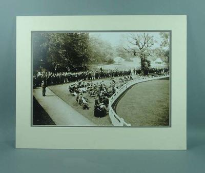 Mounted black & white photograph of spectators at a cricket match