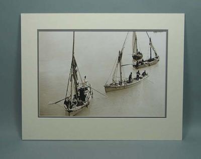 Photograph of four sailing boats on the ocean in Suez
