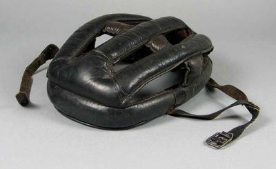 Dark brown leather cycling helmet, worn by Eric Gibaud
